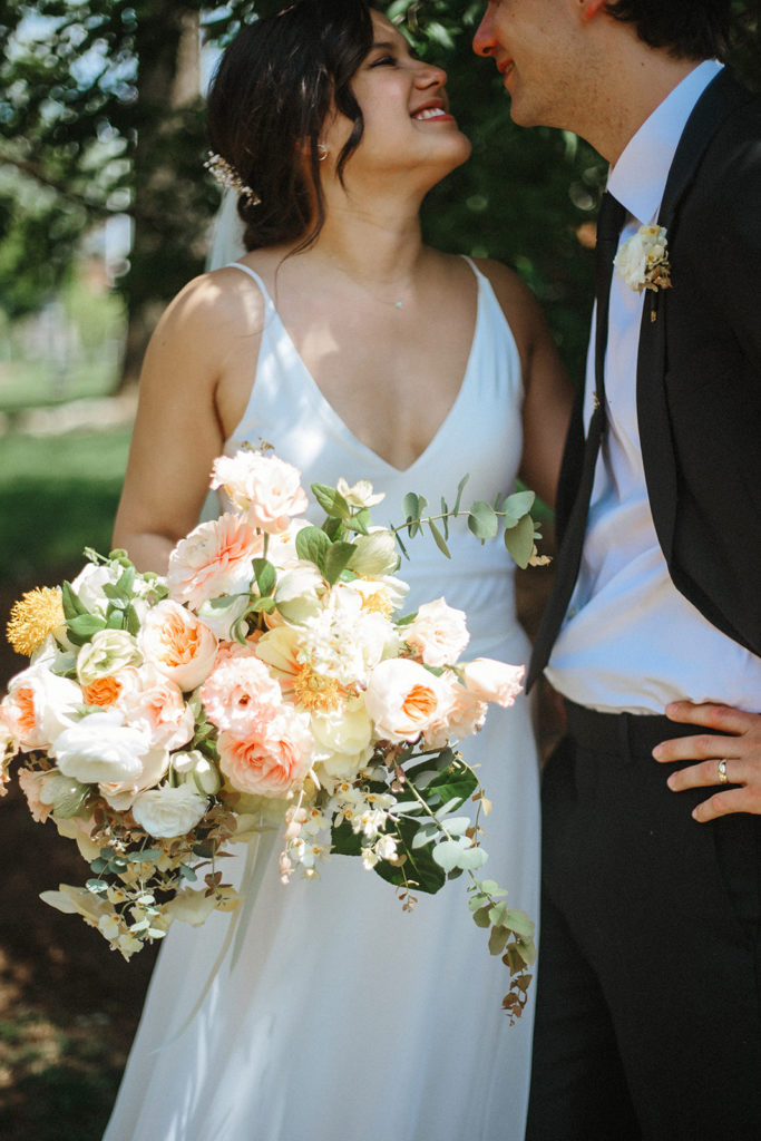 wedding couple and bouquet by lexington photographers held weddings