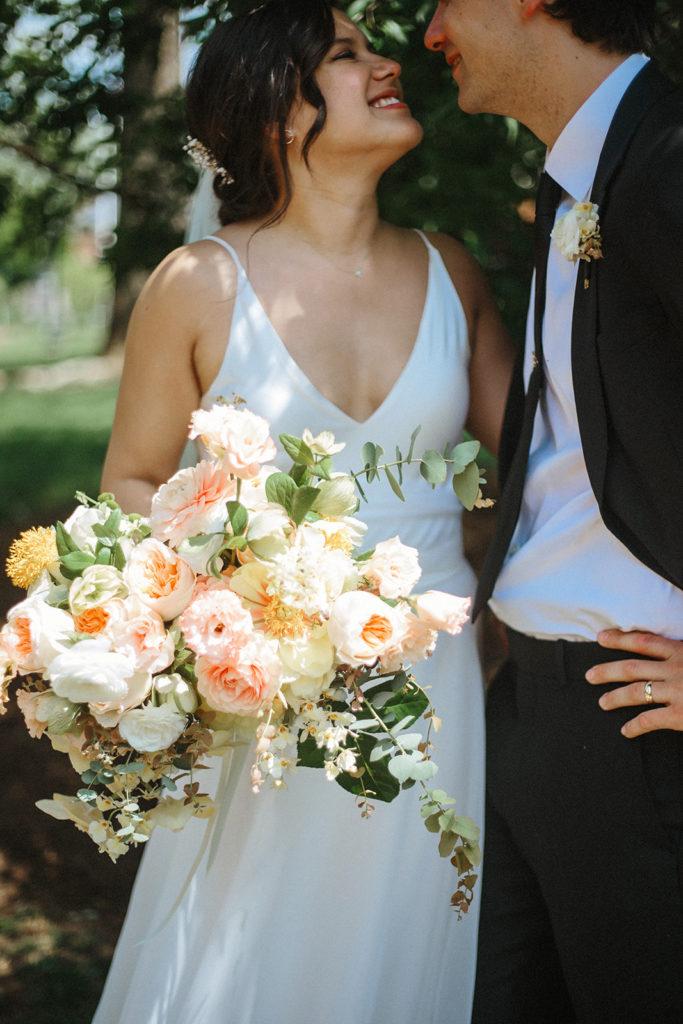 wedding couple and bouquet by lexington photographers held weddings
