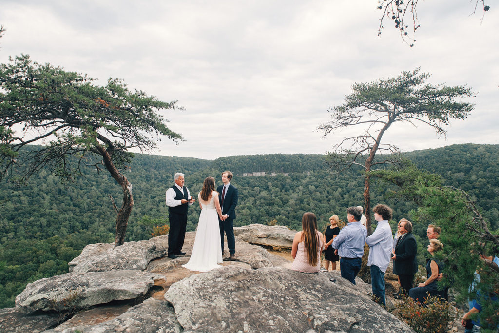 wedding ceremony on mountain cliff overlook