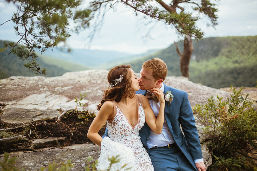 couple kissing on mountain at fall creek falls tennessee