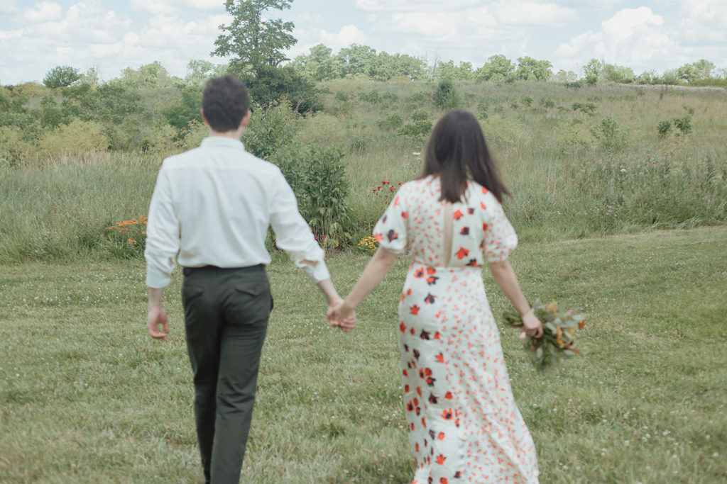 couple holding hands at lexington elopement at hisle farm park