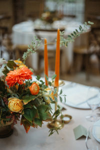 table centerpiece candles and flowers