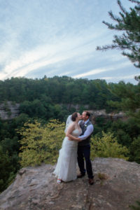 married couple standing on overlook at red river gorge